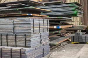 many stacks of large steel plates